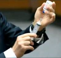 Dr. Shafer draws in some air inside the vial and then draws out of the 25ml of propofol