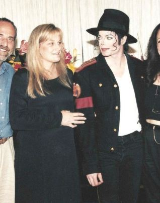 The wedding took place at night after the concert. Debbie Rowe was 6 months pregnant. Dr. Metzger was the best man