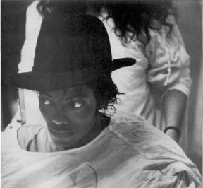 MJ is released from the hospital with a fedora covering his wound, 1984