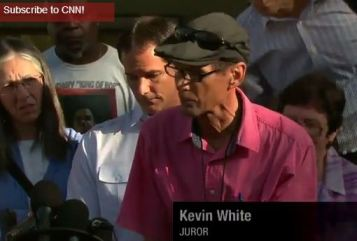 "CNN calls the juror Kevin White. The black juror is wearing a T-shirt with ""Legendary King of Pop"" written on it"