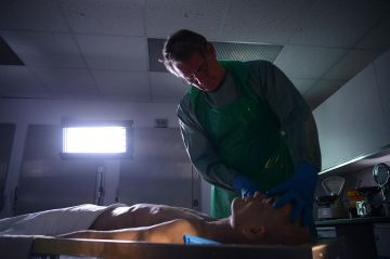 Dr. Shepherd is handling the simulated cadaver. Photo: Channel 5