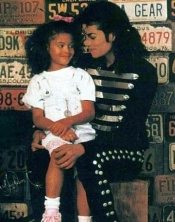 Goodness gracious! What would they say if this were a boy? [MJ with his niece}