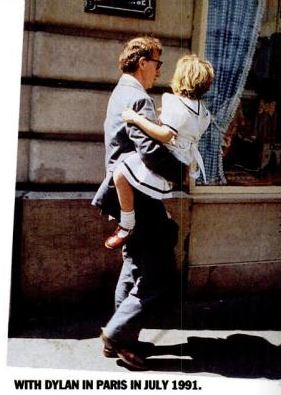 In 1991 Dylan was a girl big enough to walk on her own, so why the need to hold her in his arms and in this strange manner too?