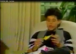 Corey Haim also gets his chicken key chain and thanks the host for the present