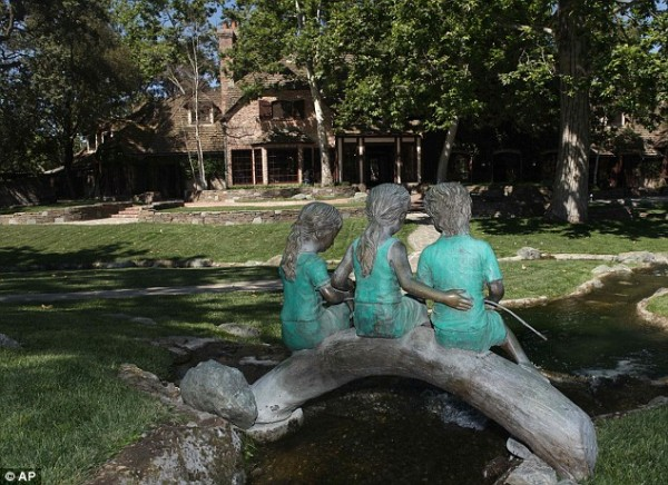 A bronze statue of three children fishing in the creek behind the main house. Photo: AP
